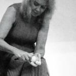 woman peeling an onion